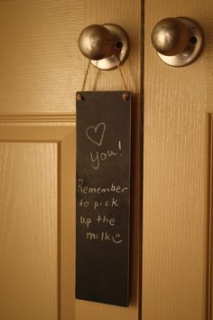 this would be cute and useful in just about any home - DIY- wood panel + chalkboard paint.