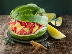 watermelon dinosaur. How cute is this!? What a great way to stick to healthy foods at a kid's party (or heck, even a grown-up party... I know plenty of adults that would think this is super cool!) fruit bowls, fruit salads, dinosaur party, dinosaur birthday, party planners, kid birthdays, fruit displays, kid birthday parties, little boys