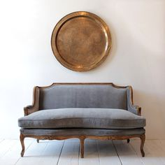 .simple antique couch with a brass dish...lovely