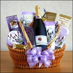 """Sparkling Lavender    """"Relax and Enjoy."""" Show her you care by sending a special treat! It includes: A bottle of sparkling raspberry cider, lavender shower gel, body lotion, moisturizing body butter, and luxuriating bath bar. Also included are English toffee, tea, Almond Roca, and Lacey's cookies. What a great way to say you care.  http://www.marysgiftbaskets"""