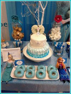 Dessert table at a Disney Frozen Birthday Party with a beautiful Frozen birthday cake and donuts!  See more party ideas at CatchMyParty.com!