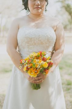Colorful bouquet | Photography: Day 7 Photography - www.day7photography.com  Read More: http://www.stylemepretty.com/2014/05/29/despicable-me-themed-wedding/