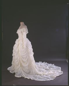 Parachute wedding dress - The parachute saved the life of pilot Maj. Claude Hensinger when he bailed out of his disabled B-29 over Japan in 1944. It was his blanket and pillow as he waited for rescue. In 1947, he gave it to his girlfriend when he proposed to her, and she made it into the skirt portion of her wedding dress. The dress was also worn by their daughter and then by their son's bride in later weddings. Now it belongs to the Smithsonian's National Museum of American History.