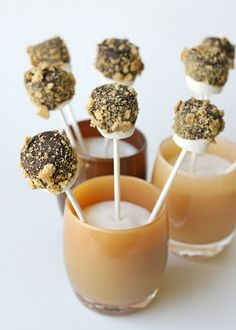 These glass containers are used for candles, but why not drink glasses? These s'more pops are the most ingenious idea!