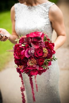 In love with the dress and the color of the bouquet.