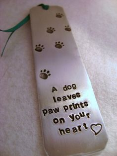 Customized metal bookmark. The paw prints are so cute!