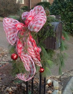 Christmas 2013 - Red & White Plaid Deco Mesh with Red & White Ribbon, Red Ornaments & a mix of Evergreens decorates this neighbor's mailbox.