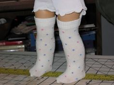 sock tutorial. Scroll through the pics. The dollar store baby socks work best!