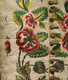 Detail embroidery, waistcoat with sleeves, England, early 18th century. Linen, lavishly embroidered with stylized floral motifs in coloured silk and metallic thread.