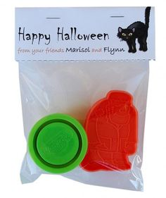 Assemble a small gift bag the kids will be excited to rip open: Simply place a small jar of colored Play-Doh and a ghoulish cookie cutter in clear cellophane bags.