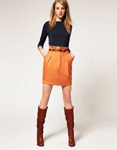 navy sweater / orange skirt / tall boots