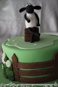 This size cake covered in green icing.  Inspiration for Mae's Shaun the Sheep theme 1st Birthday Party.