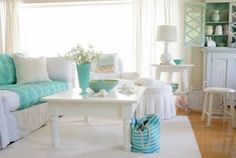 Soft cotton slipcovers for easy beach living. Colorful accessories, too...