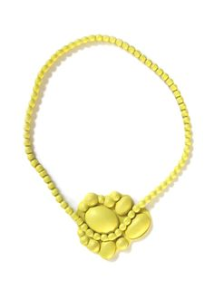 """NATALIA BRILLI - leather jewelry  """"Ever since her first collection, Natalia Brilli has imposed a unique style, with her oversize beads necklaces or he cameos encased with the finest leathers, those very used by glove makers""""  in """"http://www.huntingandcollecting.com/designers/m/natalia-brilli/"""""""