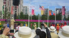 The Mongolian flag being raised at the Team Welcome Ceremony, Dep Chef de Mission on Podium with Olympic Village mayor, Sir Charles Allen. charl allen, london olymp, olymp villag, olymp 2012, sir charl