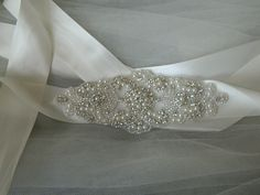 Wedding Sash/Belt,Bridal Sash,Rhinestone Sash,Beaded Sash,- Joyce -Ivory Wedding Sash. $49.00, via Etsy.