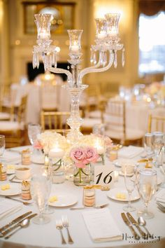 Love is sweet - so are these macaroons displayed with Emerald City's Crystal Candelabra within Lovett Hall Ballroom.  Nicole Haley Photography