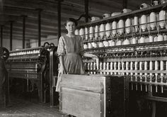 Child laborer mill girl working. By Lewis Hine.