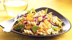 A soy sauce dressing adds Asian inspiration to a veggie and fruit pasta salad.