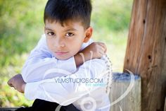 Boy first communion portrait pose