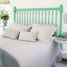 This simple headboard painted in Behr's electric Green Trance stands out without overwhelming an all-white bedroom. | Photo: Wendell T. Webber    Green Trance, Behr electric hue to stand out without overwhelming an all-white bedroom.     Green Trance, Behr