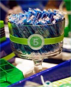 Green and blue theme pool party decorations, buckets on tables, bubbles as take home gift, blue and green banner- so cute! #YoYoBirthday