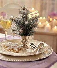 Next year... love this idea of the mini Christmas tree per place setting