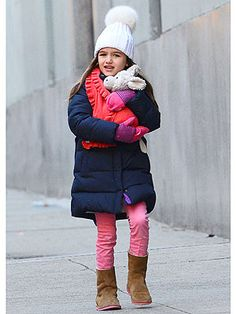 See how Suri Cruise mixes and matches her colorful and cozy pieces.