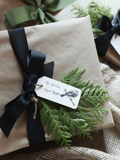 Christmas packaging: neutral paper, black ribbon, evergreen and tag.