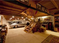Garage for a collector of fine things - I think there must be the perfect Man Cave up those stairs...