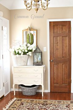 Dresser as entry table ~ love the basket of fresh flowers.