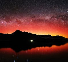Auroras are usually green, and sometimes purple, but seldom do sky watchers see this much red. Minoru Yoneto photographed this example from Queenstown, New Zealand on Oct 2