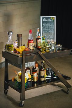 vintage-inspired bar cart, photo by Tuan H. Bui http://ruffledblog.com/1960s-inspired-mod-shoot #barcart