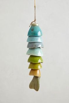 Wind Chime: ceramic  hemispheres hung close together create long body of a fish with -I'm sure- a great sound chime.  Could be done with your own clay but also upcycled old tea or espresso cups for this same thing,  fish or not. Cute!