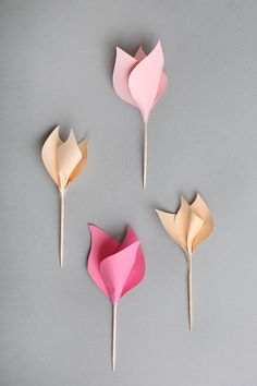 Tutorial at this link for paper tulips. I'd add green florist tape to the stem.