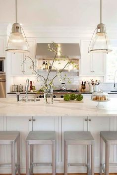 marble counter and black counter in a white kitchen.