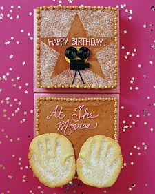 This cake sets the stage for a movie-premiere birthday party. Handprints are cast in sugar cookies to resemble the famous imprints of the movie stars; the movie camera is made of licorice candies.