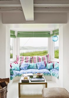 Who wouldn't want to curl up here with a favorite book?  Escape to the Coolest Coastal Home in Spain // Window seat