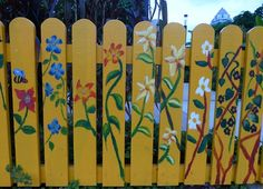 decorative fence, painted flowers on fence