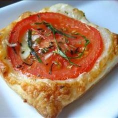 Tomato Puff Pastry Bites on BigOven: If you like tomatoes, you will love this little appetizer. You can make one or as many as you like. Great way to use some garden fresh tomatoes. You can easily sprinkle some feta cheese and olives after they are baked.