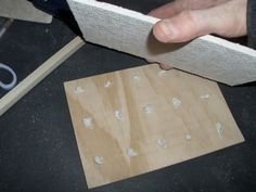 """Using liquid nails to adhere the pretreated 1/4"""" ply wood to the 1/4"""" Hardie Backer board for mosaic"""