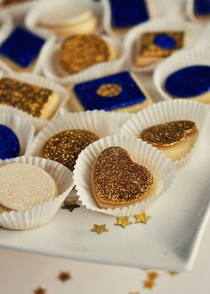 Edible glitter and jewels can transform simple cookies into works of art.  Your color scheme can work equally well.