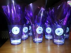 Purple cup Minions w cellophane wrap for hair and filled with goodies!