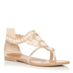 Dressy sandal with zip up back.