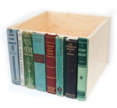 Storage bin made with old book covers about to be tossed - looks great on the shelf.
