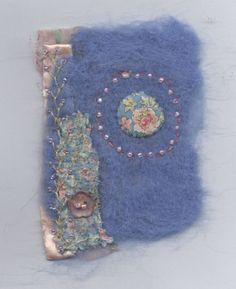 Additions to page 1. Side added as per Sara's suggestion and beads and a little embroidery.