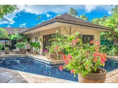 The tropical courtyard surrounds the pool and provides access to the spacious master suite. Honolulu, HI Coldwell Banker Pacific Properties $3,900,000