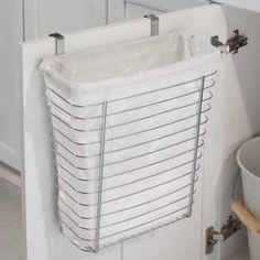 Get an over-the-cabinet-door wastebasket.