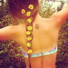 peace tattoo & flowers in hair