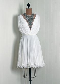 Grecian wedding dress for the evening reception worn with white tights or leggings and sky scraper heels :)